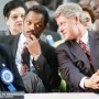 Democratic presidential candidate Bill Clinton, right, leans over to converse with the Rev. Jesse Jackson as the two attended the 112th annual national convention U. S. R. at the Georgia Dome in Atlanta on Wednesday, Sept. 9, 1992. Clinton addressed the group about national health care. (AP Photo/Curtis Compton)
